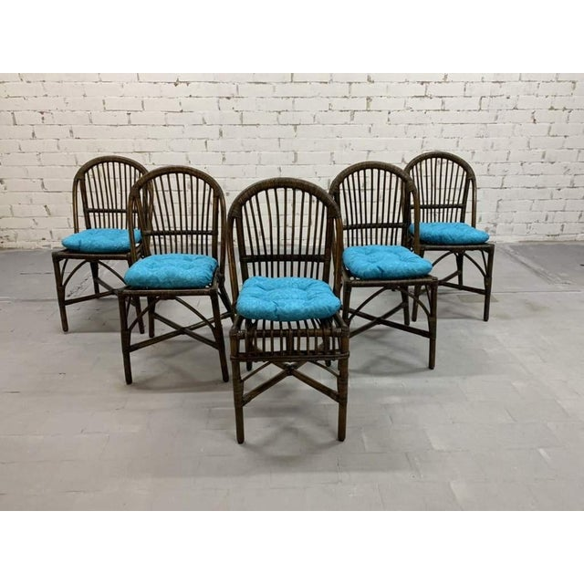 Indoor outdoor set of 5 mid-century bamboo dining chairs. Vintage turquoise blue cushions patterned with flower motifs....