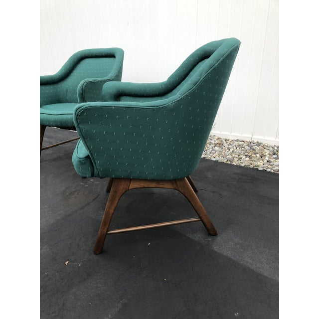 Mid century set of three Pearsall style upholstered chairs with wood base. Chairs upholstered in a green fabric. Very...