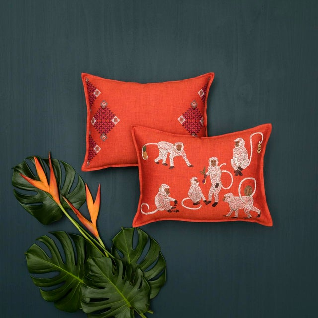 """Monkey Business Vermilion Pillow Measures 12"""" x 16"""" Pillow has a 95% small feather, 5% down insert. Embroidered front and..."""