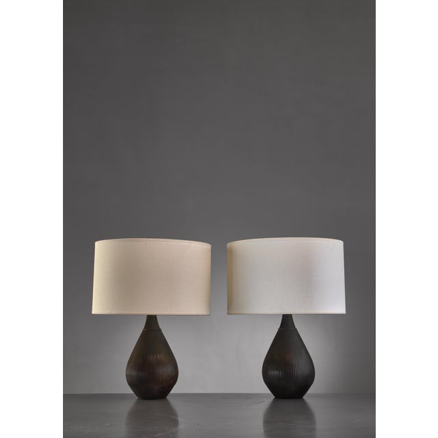 A pair of drop shaped metal table lamps by Danish designer Ib Just Andersen (1884-1943). The lamps are made of Disko...
