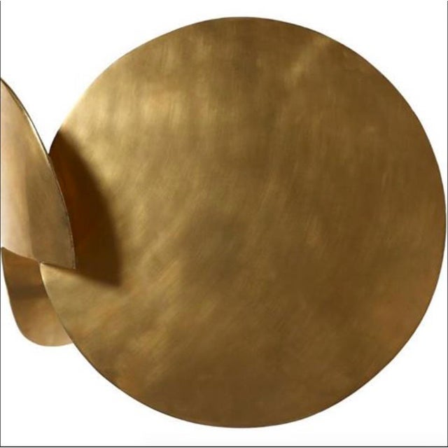 The Dina Sculptural Side Table by Yann Dessauvages, shown in Brass, is available in a variety of metals and is fully...