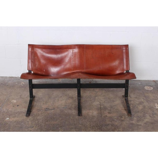 A beautifully patinated leather and iron bench by Max Gottschalk.