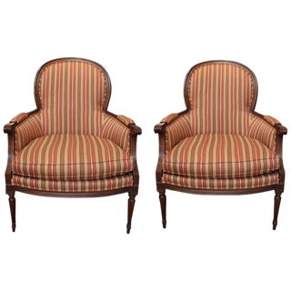Carved Walnut Bergere Chairs - A Pair For Sale