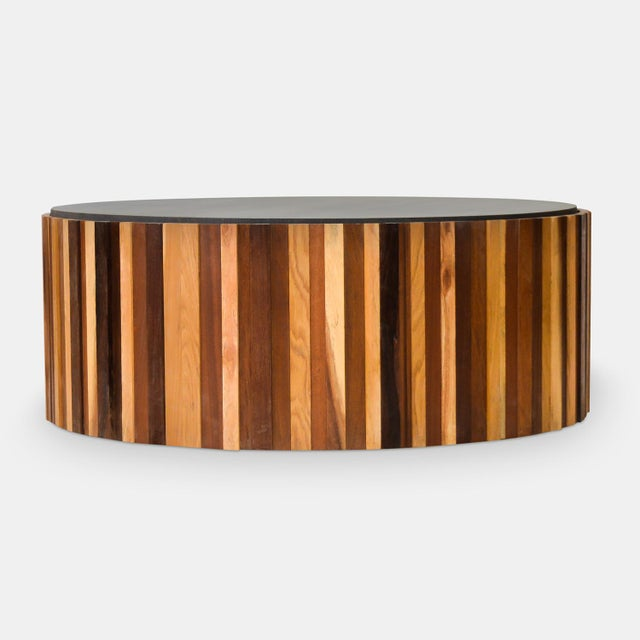 This round coffee table is made with scraps of hardwood collected from our own manufacturing process, when making...
