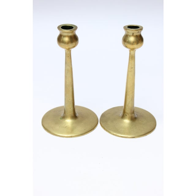 Mid-century brass turned candlesticks, each with bulbous bobeche and cylindrical stem on circular, disk base. Beautifully...