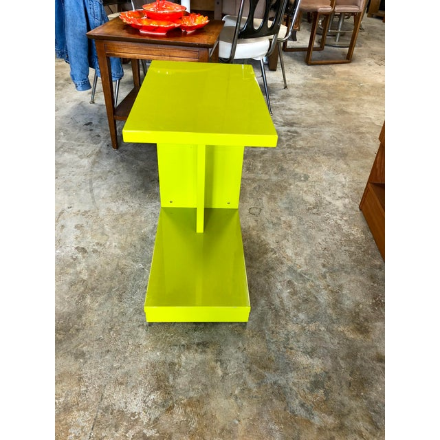 CB2 rolling C-table. Perfect for any room that needs just the right pop of color.