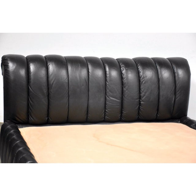 A beautiful post modern channeled black leather bed designed by Jay Spectre for Century Furnitue. No rips or tears. The...