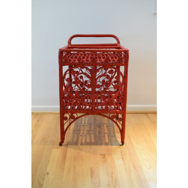Such a fun pop of color to add to any decor! This red rattan bar cart has wheels to be able to move it around with ease....