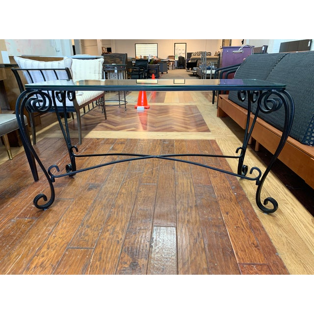 Design Plus Gallery presents a Italian Style Wrought Iron Scroll Base + Glass Console. Powder coated black metal bases in...