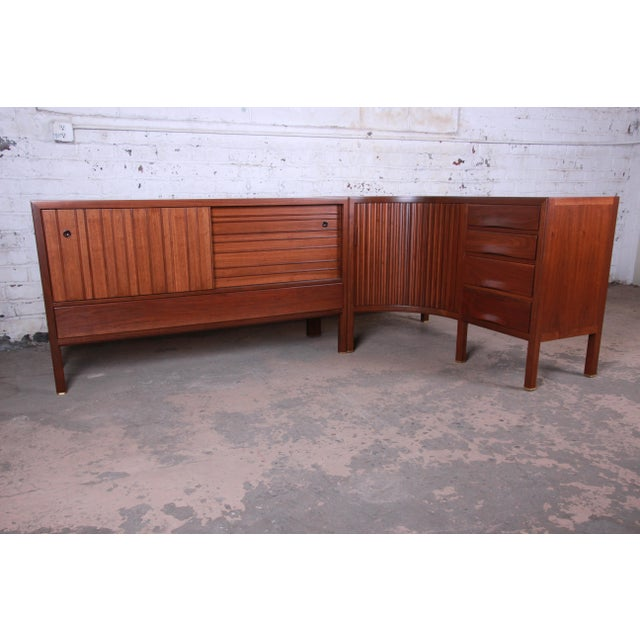 An extremely rare and exceptional mid-century modern two-piece curved corner credenza designed by Edward Wormley for...