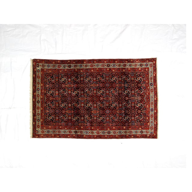 Wool pile hand woven antique navy and red Persian Ferahan rug. In excellent condition.