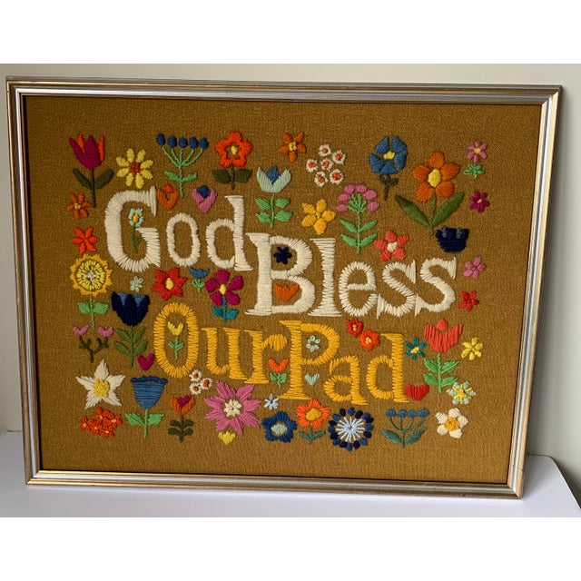 1960s hippie chic framed God Bless Our Pad Crewelwork. Recently custom framed in silver/gold gilt wood frame. Frame does...