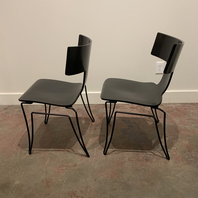 This beautiful pair of black lacquer Anziano Chairs were designed by John Hutton for Donghia and are in excellent condition.