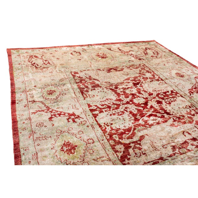 Rug & Kilim superb traditional Oushak rug is stunning. The regal red border and charming beige field is accented in muted...