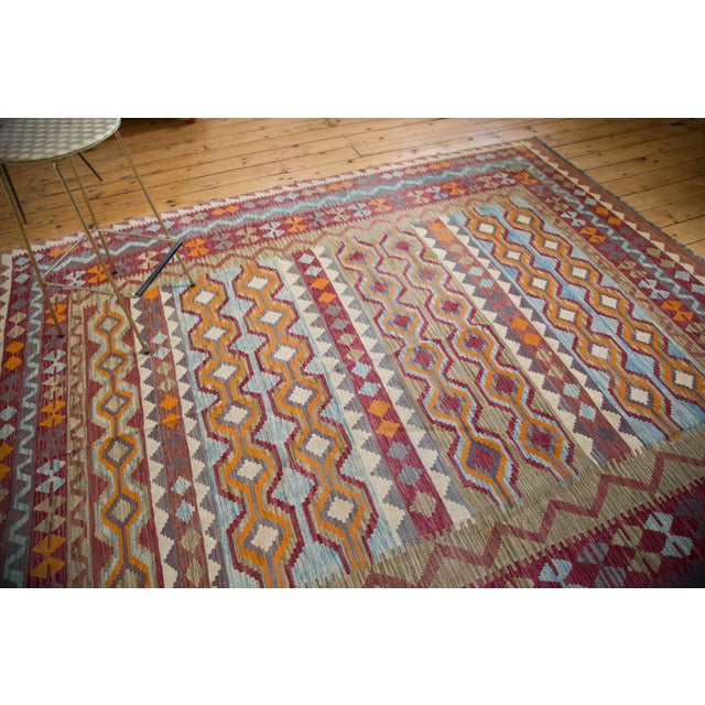 Fun implied movement within the motif of this tribal feeling Kilim carpet. Design is based on running channels of water...