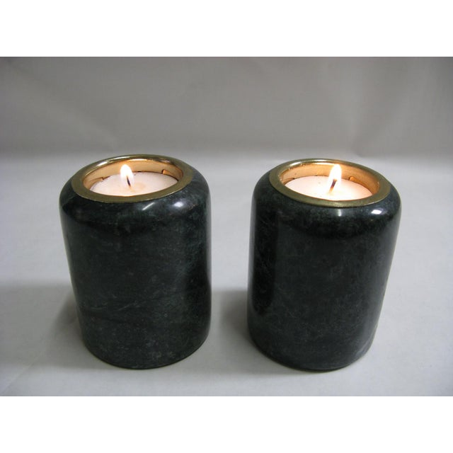 A pair of green marble candleholders. Add color to any shelf or table with these handsome candleholders. Fits tea light...