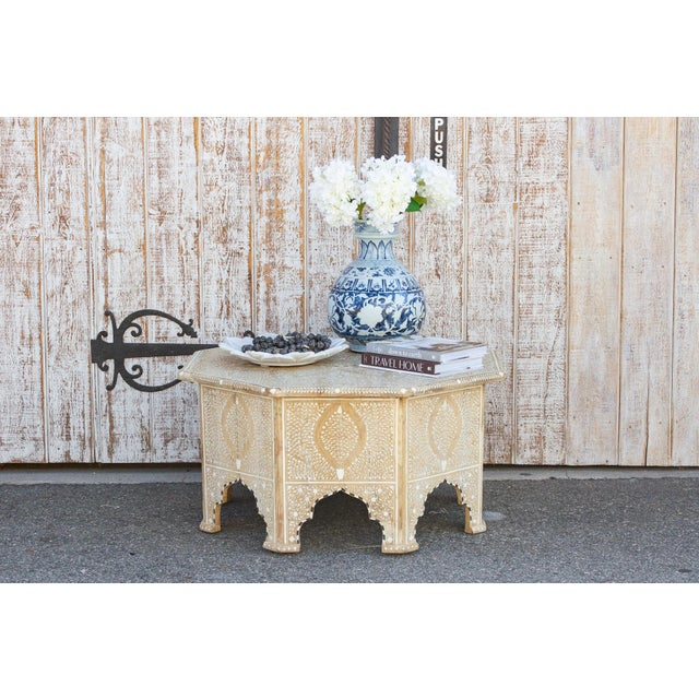 A lovely reconstructed coffee table adorned all around with fine and intricate inlay work. This rustic boho coffee table...