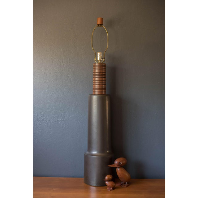 Mid-century modern tall pottery lamp by Jane and Gordon Martz for Marshall Studios. This oversized piece has a charcoal...