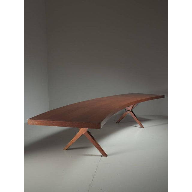 A unique and very large desk or conference table, made by L.E Brevilly, from circa 1965. The desk is made of an oak veneer...