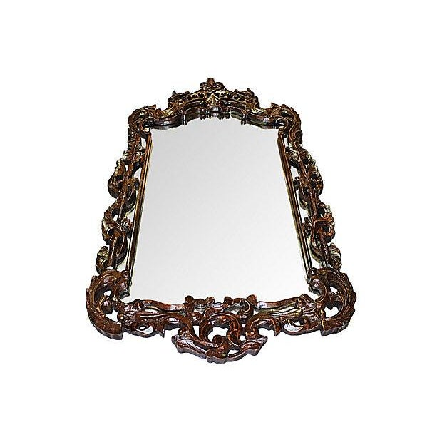 "A hand-carved wooden mirror with a reticulated frame. This mirror measures 18.5"" x 36"" and is in excellent condition,..."