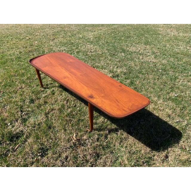 Long teak coffee table having a sculptural edge designed by Arne Hovmand-Olsen for Jutex. Fabulous vintage condition....