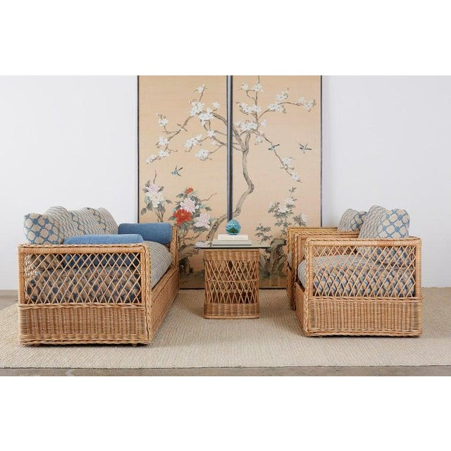 Extraordinary organic modern rattan and wicker daybed sofa made by McGuire. Features a large wood woven rattan and wicker...