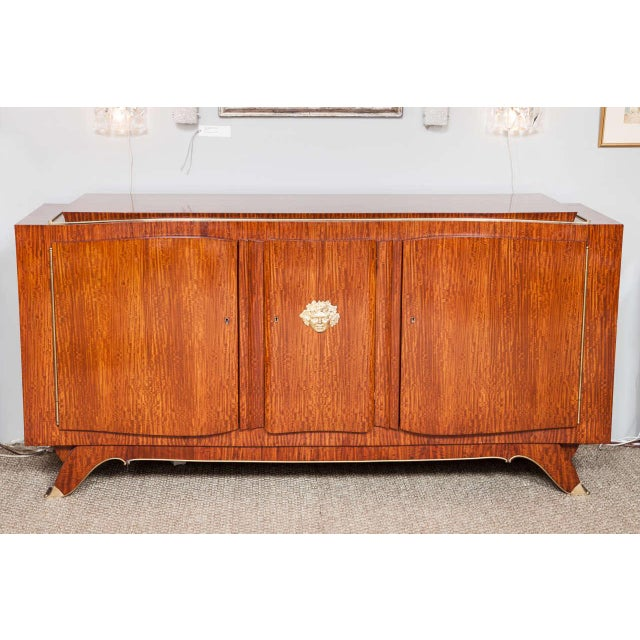 This exceptional rosewood and bronze buffet was designed and signed by Jules Leleu, the legendary French furniture...