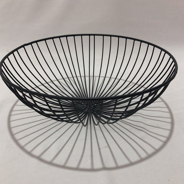 Interesting wire bowl hand crafted in India. Perfect to hold fruit in modern industrial style kitchens or for modernist...