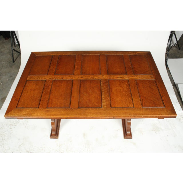 C.1940 Belgian trestle dining table featuring a solid oak construction, paneled top, and extendable leaves. Signed by...