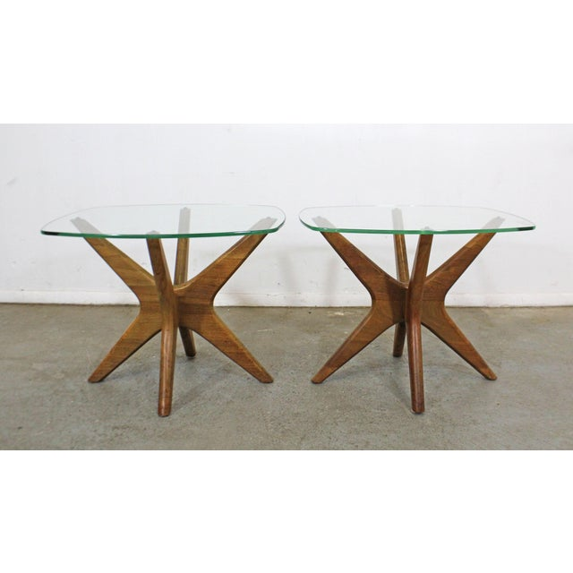 Offered is an authentic pair of vintage Adrian Pearsall 'Jacks' end tables with sculpted wooden bases and thick glass...