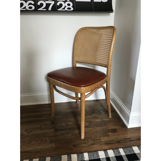 Canned back chair in the style of Josef Hoffman. Features rust colored vinyl seat.