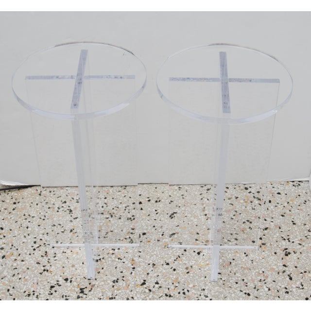 This stylish pair of Lucite tables are custom fabricated by Iconic Snob Galeres and can be purchased as a pair and we also...