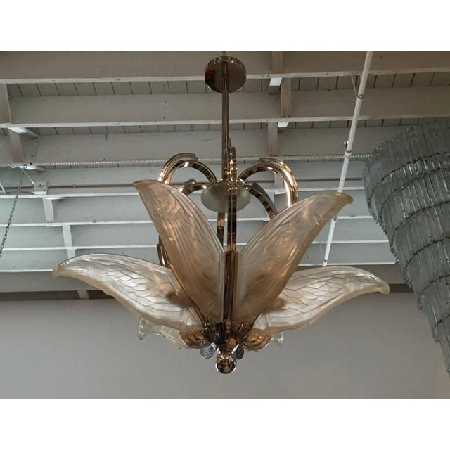 Stunning French Art Deco geometric chandelier. Having six molded clear frosted glass geometric flying bird panels. The...