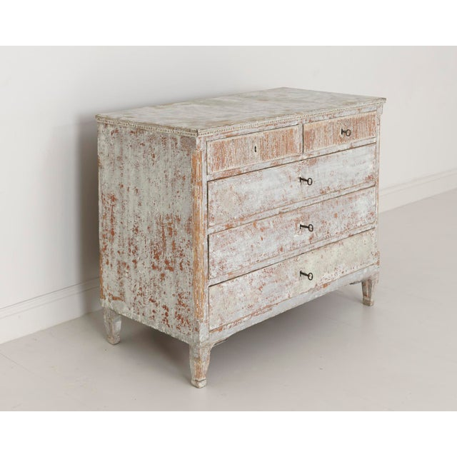 A stunning Swedish commode from the Gustavian period hand-scraped to reveal the original, soft gray paint with traces of...