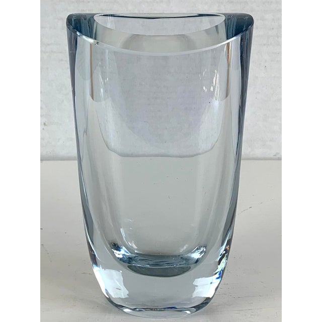 A large Mid-Century Swedish Modern crystal art glass vase. Beautifully hand-blown, thick, clear/ice blue glass. This heavy...
