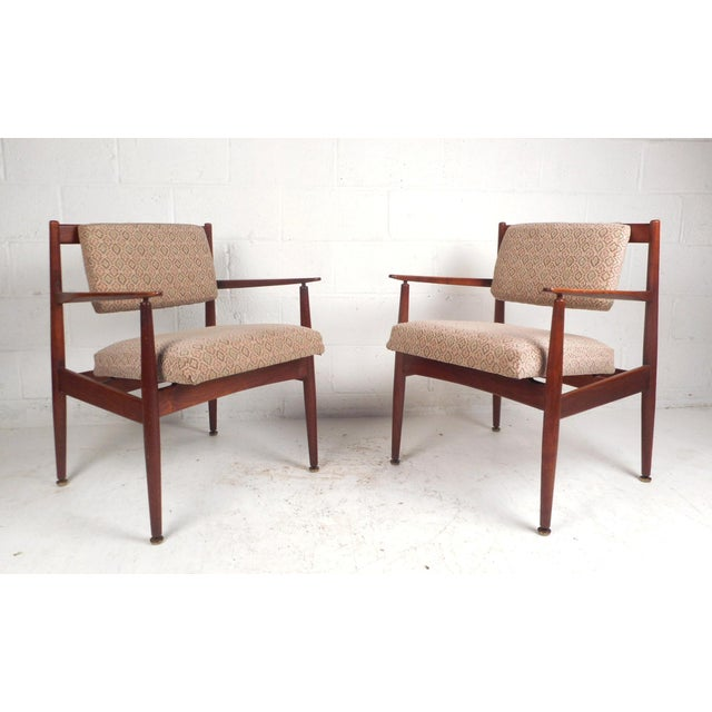This stunning pair of Mid-Century Modern arm chairs by Jens Risom Design feature extremely thick padded seating, a...