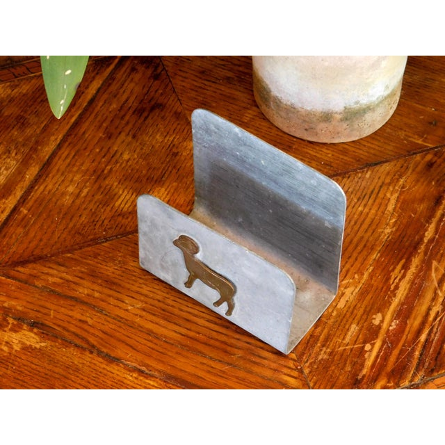 Add a farm house look and feel to your dining table or kitchen with this brass ram on galvanized metal napkin holder....