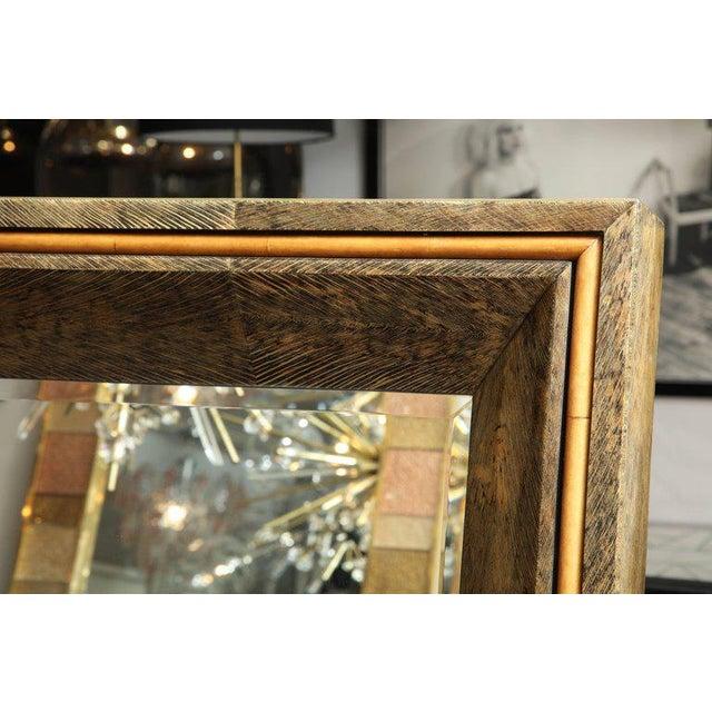 Enormous coco fiber mirror with orange goatskin insert.