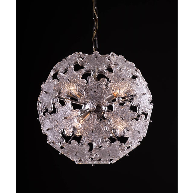 Elegant starburst pendant lamp designed by Paolo Venini. Chromed stems and hardware and steel fixture. Newly rewired with...