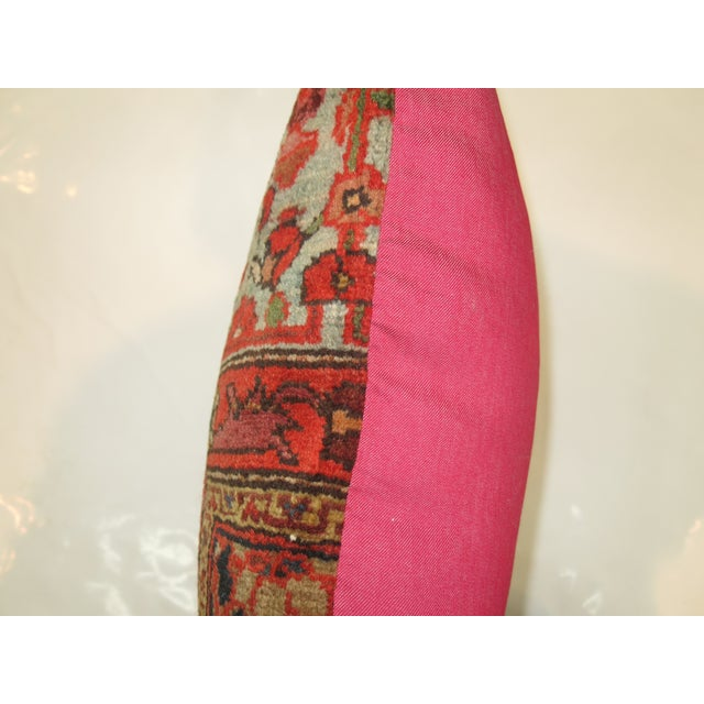 Pillow made from a persian malayer rug with pink cotton back. Zipper closure and foam insert provided. 24'' x 24''