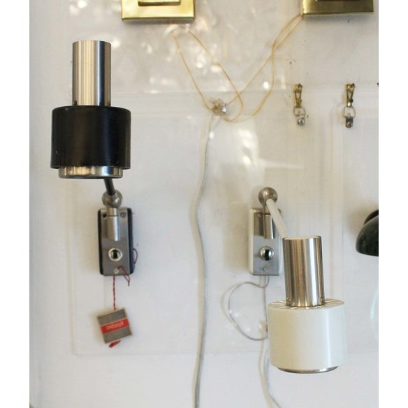 Adjustable sconces by Stilnovo with flip switches. The company logo is stamped on the back plates and the original tag is...
