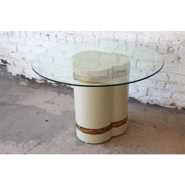Offering a gorgeous acid etched pedestal dining table designed by Bernhard Rohne for Mastercraft. The table features a...