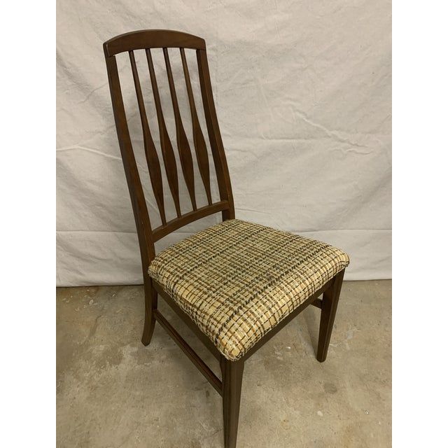 A beautiful set of 4 mid century modern dining chairs made by Keller, without tags. The construction is solid oak with a...