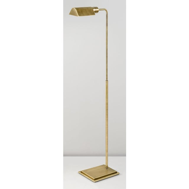 An English brass lamp with a rectangular stepped base and tubular column with a triangular canopy. The upright column...