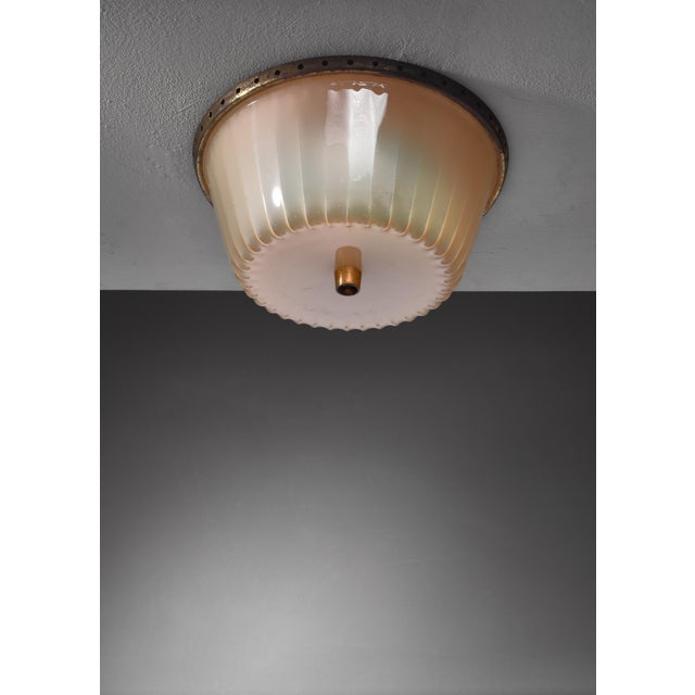 A rare Lisa Johansson-Pape model 71-137 flush mount ceiling lamp for Orno. The lamp is made of a fluted acrylic shade on a...