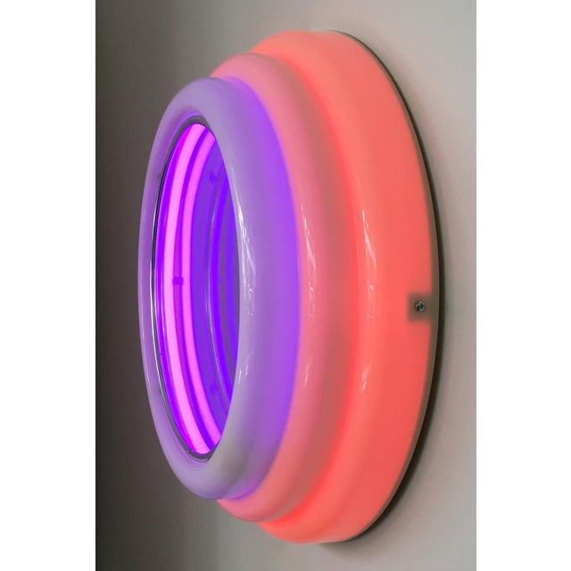 Sottsass style round sculptural acrylic wall mirror with neon lights. off-white molded stepped acrylic form with two...