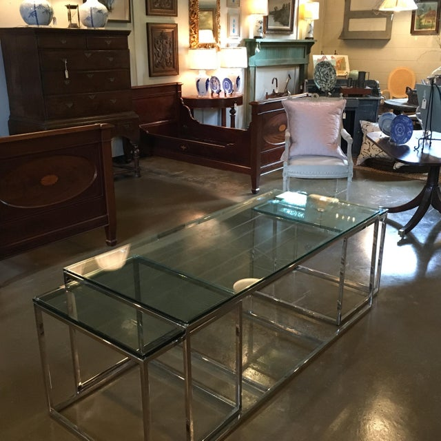 Polished crome coffee table with glass top and two side tables