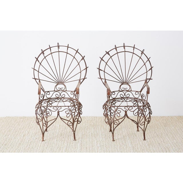 Phenomenal pair of miniature wrought iron peacock chairs designed by John Salterini. This diminutive set of doll size...