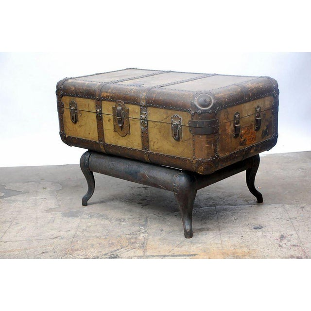 Vintage Indestructo trunk on patinated iron Stand. Great as a coffee table or a low console.