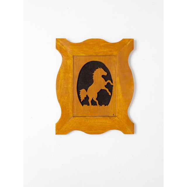 Offered is a vintage wood horse silhouette art in matching frame. The slender wood cut-out art features a horse against a...